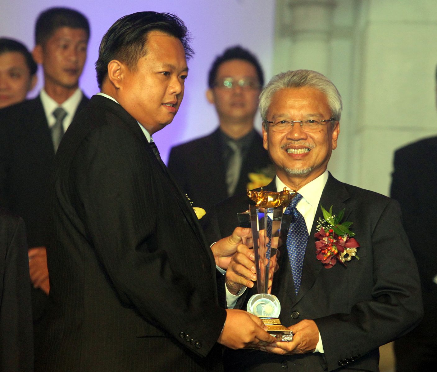 The Moment of receiving the trophy from the Minister of Finance 2